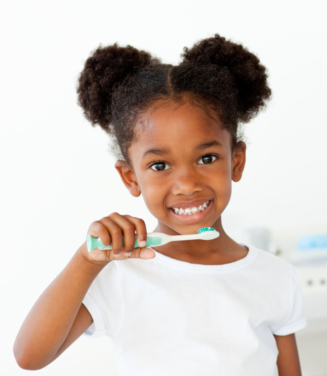 Portrait of an Afro-american girl brushing her teeth